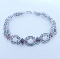 Vintage Silver Tone Red Rhinestone and Marcasite Bracelet by BorrowedTimes on Etsy https://www.etsy.com/listing/259909872/vintage-silver-tone-red-rhinestone-and