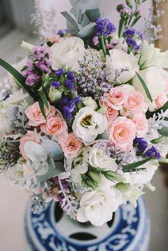 purple and pink bouquet - photo by Lara Hotz http://ruffledblog.com/waterside-destination-wedding-in-bali #flowers #weddingbouquet #bouquets