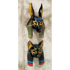 As symbols of power, ancient Egyptian wall masks have held court by depicting some of the greatest symbols of the known world. Anubis, the jackal god, is said to be the guardian of the domain while th