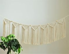 Macrame banner made with soft cotton rope with decorative wooden balls. Will look great on wall or as a fireplace decor. Natural look will give your interior boho look. It would be also perfect as a minimalistic decoration for nursery or kids room.   READY TO SHIPP in 1-3 business days  >> color: natural cotton/ecru/beige/linen  > measurements: Length of hanging rope is approx. 120cm/ 47 inch and there are loops on the ends  Macrame height - 27cm/ 10 inch (w...