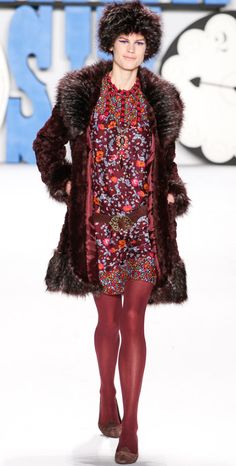 Anna Sui! Her Fall Winter 2012 2013 collection was colorful, printful and cheerful! Bright tights, knee high checkered socks, shearling and lace. All in the fifties – sixties vib