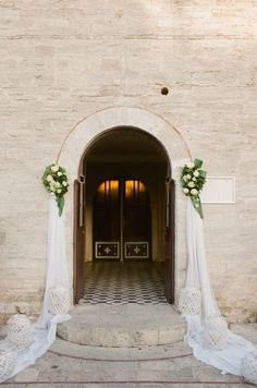 Elegant entryway: http://www.stylemepretty.com/destination-weddings/2015/11/21/elegant-white-wedding-in-greece-2/ | Photography: Peter & Veronika - http://peterandveronika.com/language/en/