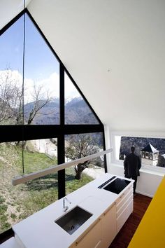 Architects Cadaval & Solà-Morales added this steeply-pitched roof to an old dry stone construction in the Spanish Pyrenees to form two homes. Nestled into the mountainside on a former farm the building has windows along one side overlooking the valley and a tall window in the gabled end affording views up the mountain. The building More