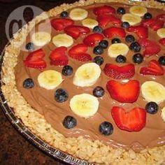 Foto da receita: Pizza de fruta e chocolate com massa de flocos de arroz