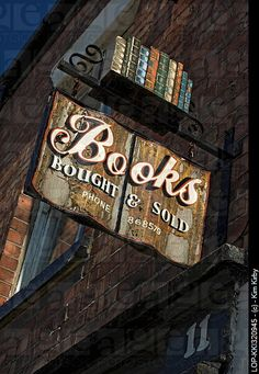 England, East Riding of Yorkshire, Beverley, An old wooden bookshop sign mounted on a wall outside.