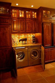 Clever use of kitchen space allows for a full sized washer and dryer plus still more cabinet space. Don't need to cover w/d fronts with cabinet doors. Another more casual option - skirt it. Remove coat closet and open up whole wall in eat-in area.