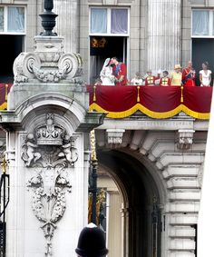 Prince William, Duke of Cambridge and Catherine, Duchess of Cambridge join their families on the balcony of Buckingham Palace for the kiss that the world had been anticipating.