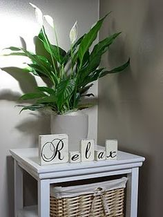 Small entryway table. Love the block words!!