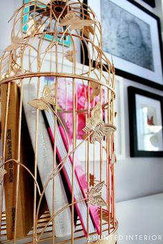 Books in a bird cage. So clever!  Via 6th Street Design School