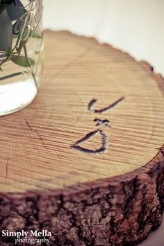 Carve initials in large wooden centerpieces.