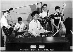 Gene Vincent and an early version of the Blue Caps - my grandfather is in this picture!  :)