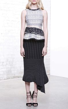 Crisp white shirting comes ruffled and tailored trousers return in high-slit wide-legged glory. This Pre-Fall, feminine charms seduce menswear silhouettes for a collection that blurs the lines. The season's highlight, patch-worked dresses and peplum tops that collage together pinstripes, windowpane prints, and boyish checks, showcase Simkhai's flair for fabric manipulations. (Gender) neutral couldn't be anymore definitive in this case: the look is certainly more hers than his.