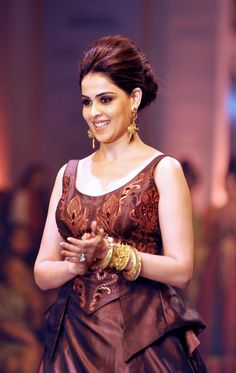 Genelia D'Souza smiles at the audience at a fashion show. #Fashion #Style #Beauty #Bollywood