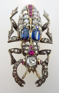 Sapphire, ruby, and diamond beetle brooch set in silver and gold. English, circa 1870.