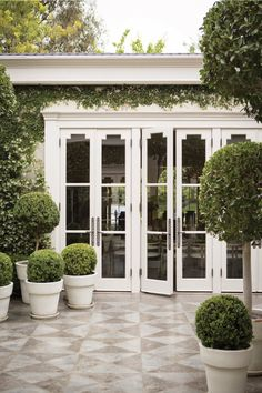 Greenery, Topiaries, French Doors, and Tiled Courtyard