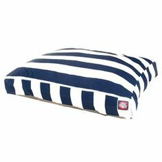 """Rectangular indoor/outdoor pet bed with a stripe motif.  Product: Pet bedConstruction Material: Polyester and polyfillColor: Navy blueFeatures: Vertical stripe patternZippered slipcoverOutdoor treated polyester with up to 1000 hours of UV protectionWaterproof 300/600 denier fabric baseDimensions:   Small: 4"""" H x 36"""" W x 29"""" DMedium: 5"""" H x 44"""" W x 36"""" D Large: 5"""" H x 50"""" W x 42"""" DCleaning and Care: Machine wash warm and tumble dry low"""