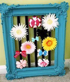 Painted/ribboned frame to hold hairbows, etc. Could also use cup hooks across frame and hang necklaces.