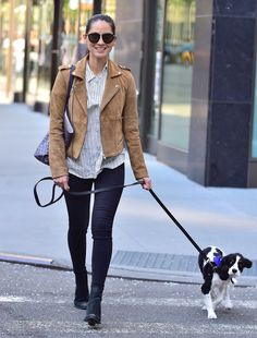 Olivia Munn walked her dog wearing skinny jeans, a striped Madewell button-up and a camel suede moto jacket luxe enough to lust over.                  Source: Getty / Alo Ceballos