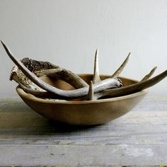 bowl of antlers- coffee table underneath Log Cabin Living, Door Crafts, Antler Art, Hearth And Home, Mason Jar Lighting, Cabins And Cottages, Oh Deer, Wooden Bowls, Cabins In The Woods