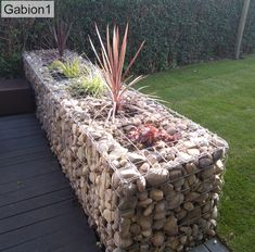 Gabion wall with planter tubs inserted Backyard Garden Design, Backyard Landscaping, Small Gardens, Outdoor Gardens, Gabion Wall Design, Rock Wall Gardens, Garden Gates And Fencing, Gabion Baskets, Garden Structures