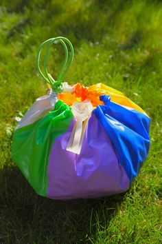 Beach Ball Beach Tote - When your beach ball gets a hole in it, turn it into a beach tote.  What an awesome idea and so easy - Kids would love this (and honestly - so do I)! '+_