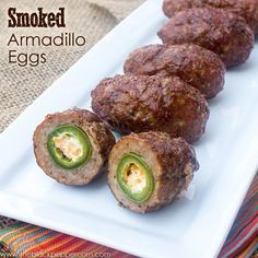 Yucky name, but Yummy taste! Smoked Armadillo Eggs Recipe a.a Jalapeno Popper Wrapped and Covered in Sausage . I don't have a smoker so I'm just baking them in my oven like a basic Baked Scotch Egg (which are amazing, too! Traeger Recipes, Grilling Recipes, Smoker Grill Recipes, Smoked Meat Recipes, Oven Recipes, Electric Smoker Recipes, Beef Brisket Recipes, Jerky Recipes, Smoker Cooking