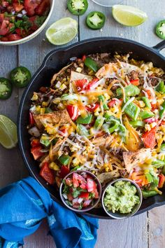 These Loaded Vegetarian Nachos are made with a blend of walnuts, mushrooms, veggies and spices. So they're hearty and flavourful, but also full of fibre and healthy fats. Perfect for weekend snacking or a get together with friends! #nachos #vegetarianrecipes #vegetariannachos #cleaneating #cincodemayo