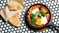 Shakshuka—a combination of poached eggs, cumin and a rich, smoky tomato sauce—is a staple Israeli dish. Get the complete recipe at Tasting Table.