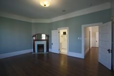 MATERIALS/ FLOOR: Hardwood floors/ WALLS: Wood panels under the windows; rest of the wall are smooth/ LIGHTS: Pendent light in the middle on the room provides all the needed light/ CEILING: Smooth ceiling; ceiling has antique  vines with flower decals that go 360 degrees around the ceiling/ TRIM: Base board trim, trim around windows and doors, as well as crown molding/ FIREPLACE: Antique fire place from Victorian Era, that was wood engravings on the wood mantle/
