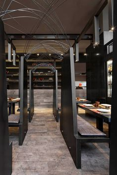 Estudi Josep Cortina has designed the Umo Japanese Restaurant as part of Hotel Catalonia in Barcelona, Spain.