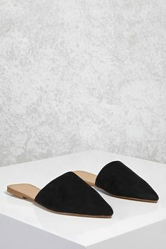 A pair of faux suede flats featuring a pointed toe, a slip-on design, and a square back.