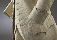Detail of sleeve and cuff of a man's cream silk wedding suit, 18th century, part of the costume collection at Ham House, Surrey.