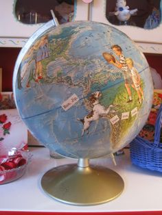 Use Mod Podge to glue vintage children's book images onto a globe for a fun vintage look.