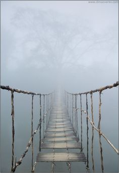 rope bridge concealed by the fog in Vietnam