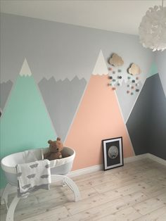 Our girl's nursery so far! Peach, grey and mint mountains