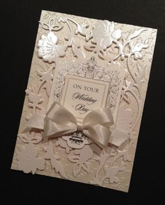 This wedding card has such charm and sweetness, and frankly, my photos dont do it justice. I used designer paper for both the embossing and