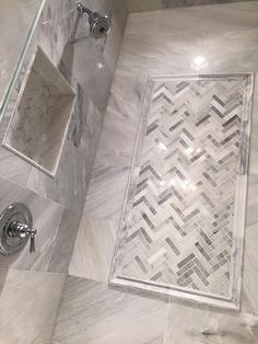 Master bathroom by Link Renovations. Carrera marble tile with herringbone accent tile. #linkrenovations