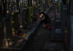 ontologicalterrorist:    A woman places flowers on the tomb of her deceased family member at a cemetery on the Qingming Festival in Beijing, China on Tuesday. Qingming festival, also known as the Grave Sweeping Day is a day when Chinese around the world remember their dearly departed and take time off to clean up the tombs and place flowers and offerings. (AP Photo/Andy Wong)