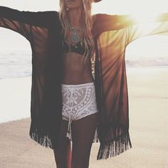 Shop this look on Lookastic:  http://lookastic.com/women/looks/silver-necklace-black-bikini-top-black-kimono-white-shorts/10372  — Silver Necklace  — Black Crochet Bikini Top  — Black Chiffon Kimono  — White Crochet Shorts