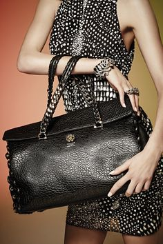 The Roberto Cavalli #ReginaBag in black leather is a classic accessory every stylish woman must own.