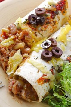 Beef Enchiladas - (Well, THIS is certainly easy! If you have ground beef, flour tortillas, black olives, cheddar cheese and a packet of dry enchilada sauce, you have all the ingredients you need.)