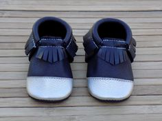 At Jaxos Toes we hand cut, and sew each individual shoe.  Our moccs are made with only the highest quality sustainable leather. Each moccassin is thread with just the right amount of elastic that will make the shoe easy to slip on your little love, but tight enough that it will stay on! Each mocc is adorned with an adorable arrow on the sole, which is our signature, and also gives your child grip while on the move. The half moon that we have carefully placed on the back of the shoe ...