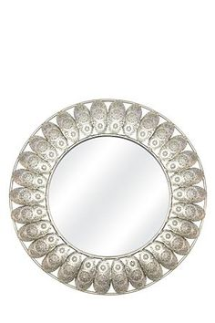 This decorative mirror with tin cut out detail will add interest to a home interior.