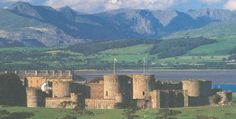 Beaumaris Castle, Wales, with Snowdonia in the distance