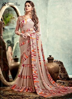 Get going with this majestic and wonderful piece and make your dream attire look richer to your persona. You are sure to make a strong fashion statement with this multi colour weight less printed sare...
