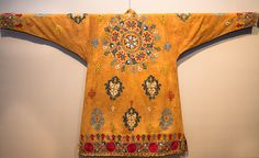 An embroidered Kazakh coat from 19th-century Uzbekistan is one of the items on display at the exhibition at the Textile Museum.