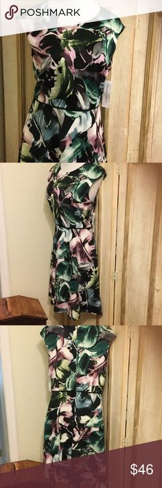 Absolutely gorgeous nwt dress! No low balls please This beautiful new with tags Maggy London dress has never been worn. Pit to pit 19 & 41 inches long. Waist lying flat 17 inches. Maggy London Dresses