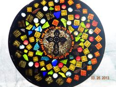 Glass Mosaic with crematory ashes within the cross.  See More at www.artfullycontained.com