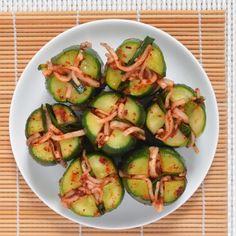 Cucumber Kimchi Bites Recipes from The Kitchn  1 1/2 pounds cucumbers  2 tablespoonkosher salt  2 teaspoons grated garlic  1 teaspoon grated ginger  1-2 tablespoons Korean red pepper flakes (gochugaru)  1 teaspoon sugar   4 ounces Korean radish or daikon  2 ounces chives  Sesame seeds for sprinkle