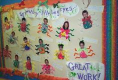 Bulletin Board with kids faces and bug bodies.  The kids can decide if they want to be a creepy bug or a beautiful butterfly.
